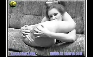 Nude Contortionist Sits On Her Own Face