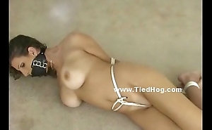 Gorgeous woman gets her nipps clamped