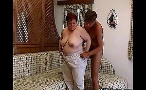 Elderly fat woman sucking hard in a guy'_s