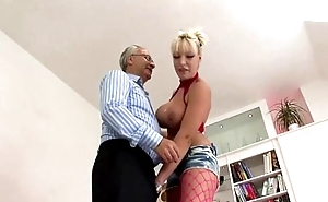 Busty whore screws superannuated cock