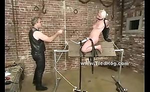 Blonde hanged upside bristles ceiling