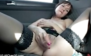 Brunette milf Cindy toying surrounding get under one's car