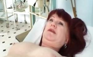 Mature old redhead Olga visiting her gyno doctor for proper consummate mature pus