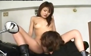 Oriental bikerchick acquires her pussy tickled