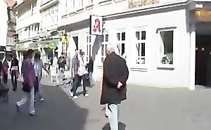 Horny brunette naked in public streets