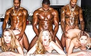 Yoke stunning blonde ladies servicing muscled black dudes