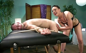 Short-haired mistress with respect to small tits dominates intemperance her flunkey