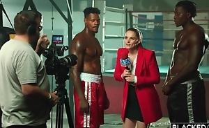 Two world-famous black boxers burgeon gorgeous reporter