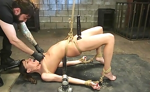 Bearded stallion ties up and bonks pigtailed brunette in both holes