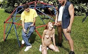 Bald-headed stallion fucks Lilliputian redhead girl outdoors